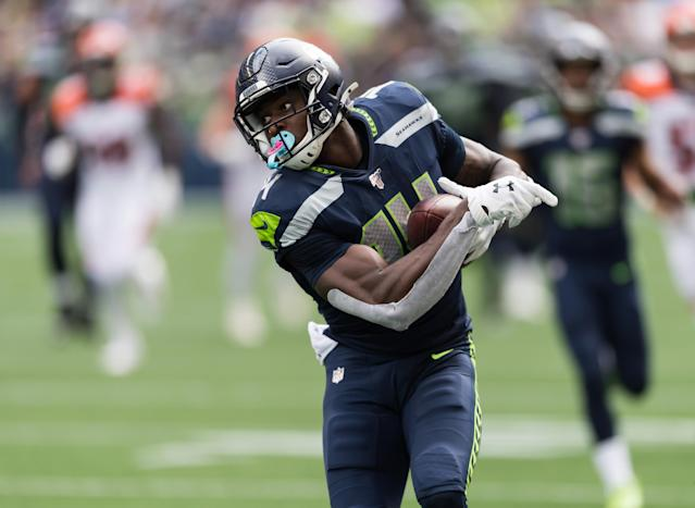 Big catches weren't the only part of D.K. Metcalf's NFL debut drawing attention on Sunday. (Reuters)