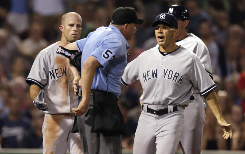 New York Yankees manager Joe Girardi, right, argues with home plate umpire Mike Everitt after Brett Gardner, left, was ejected for arguing a strikeout call during the fifth inning of a baseball game at Fenway Park, Friday, July 19, 2013, in Boston. (AP Photo/Charles Krupa)