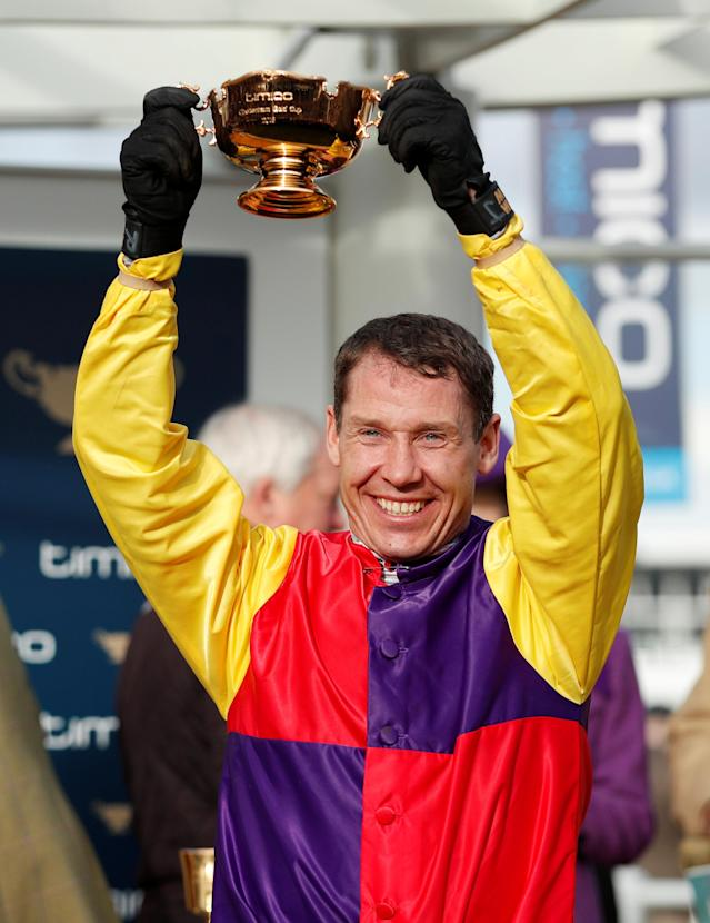 Horse Racing - Cheltenham Festival - Cheltenham Racecourse, Cheltenham, Britain - March 16, 2018 Richard Johnson celebrates with the trophy after riding Native River to victory in the 15.30 Timico Cheltenham Gold Cup Chase Action Images via Reuters/Andrew Boyers
