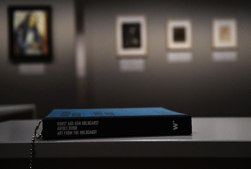 A catalogue is pictured at the exhibition 'Art from the Holocaust -100 Works from the Yad Vashem Collection' in Berlin on January 25, 2016 (AFP Photo/Tobias Scwarz)