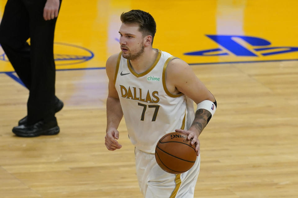Dallas Mavericks guard Luka Doncic dribbles the ball during the second half of the team's NBA basketball game against the Golden State Warriors in San Francisco, Tuesday, April 27, 2021. (AP Photo/Jeff Chiu)