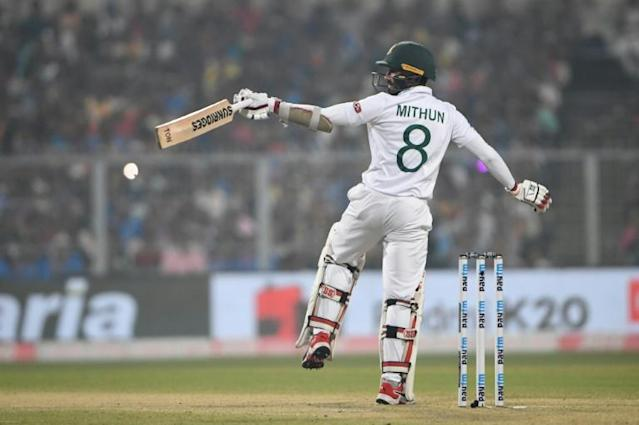 Mohammad Mithun was one of four Bangladesh players hit on the helmet under the Kolkata lights (AFP Photo/Dibyangshu SARKAR)