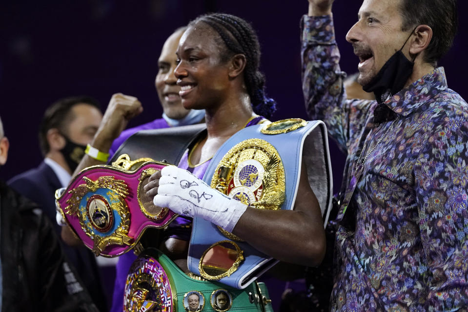 Claressa Shields holds her championship belts after defeating Marie-Eve Dicaire by decision for the women's super welterweight boxing title Friday, March 5, 2021, in Flint, Mich. (AP Photo/Carlos Osorio)