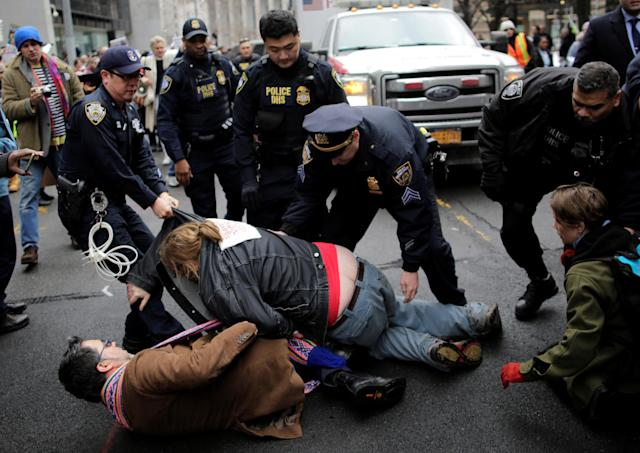 <p>Protestors clash with police as they attempt to block an ambulance believed to be carrying immigration rights activist Ravi Ragbir, the executive director of the New Sanctuary Coalition, during a demonstration against deportation outside the Jacob Javits Federal Building in Manhattan in New York City, Jan. 11, 2018. (Photo: Eduardo Munoz/Reuters) </p>
