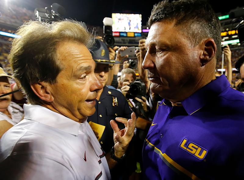 Alabama's Nick Saban and LSU's Ed Orgeron converse after a college football game between their schools. (Getty)