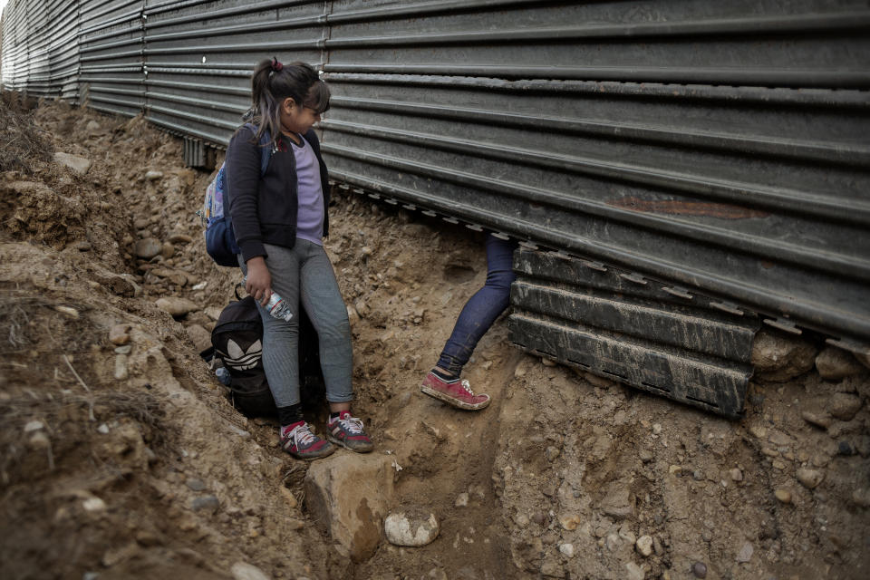 Mirna-Marely waits for her mother Mirna to cross the border wall from USA to Mexico on December 1, 2018, Tijuana, Mexico. (Photo: Fabio Bucciarelli for Yahoo News)