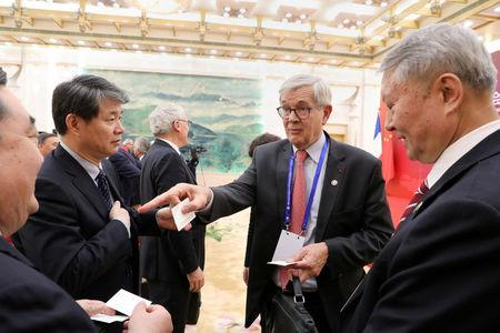 FILE PHOTO: Philippe Varin (2nd R), Chairman of the Board of Directors of Areva, meets with Chinese business leaders during the first meeting of the French-Chinese business council opened by French President Emmanuel Macron in Beijing, China January 9, 2018.  REUTERS/Ludovic Marin/Pool/File Photo