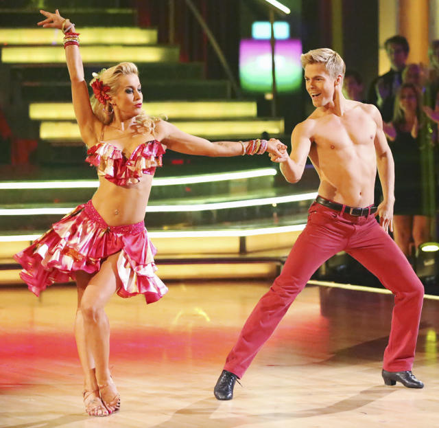 Kellie's Week 7 outfit was hot, hot, hot as she shook her bon bon for a Latin night samba that boasted a red ruffled bikini top and matching skirt that showed off her taut tummy, finished off with a long blond wig. And is that a belly piercing we see?