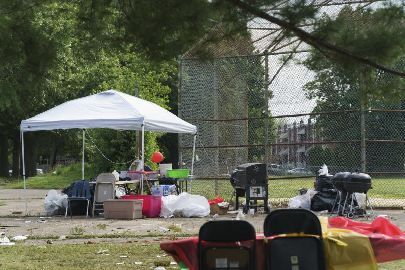 The scene of a graduation party Monday, June 17, 2019 where a gunman opened fire Sunday evening, at Paschall Playground in Southwest Philadelphia. (Jessica Griffin/The Philadelphia Inquirer via AP )