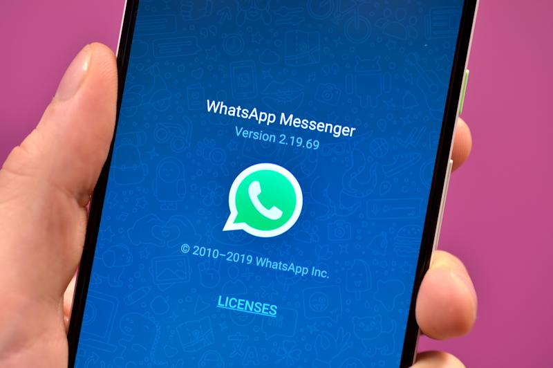 Stock photo of the WhatsApp app icon on a smartphone.