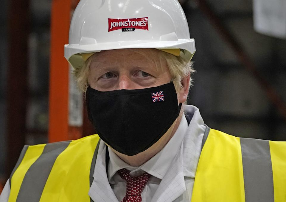 Prime Minister Boris Johnson during a visit to Johnstone's Paints Limited in Batley, West Yorkshire, ahead of the Batley and Spen by-election on July 1. Picture date: Monday June 28, 2021. (Photo by Peter Byrne/PA Images via Getty Images)