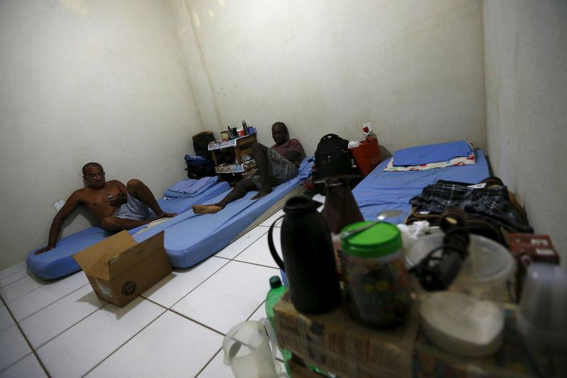 Laid-off workers of Comperj are pictured at a room of the Pousada do Trabalhador, which closed down after the scandal involving Petrobras, on its last day of operations, in Itaborai