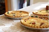 A comforting quiche is a great accompaniment at the table, for those who enjoy some cheesy, creamy goodness. Add it to a main course along with a salad, and voila, you have yourself an awesome meal. INGREDIENTS: 5 green onions, 1 tomato, 12 slices of bacon, 1 cup chopped fresh mushrooms, 12 eggs, 1 cup sour cream, 1 cup shredded cheddar cheese, 1 cup shredded mozzarella cheese. DIRECTIONS: Heat the oven to 160 C. Cook bacon in a large pan until crisp. Reserve the bacon drippings. Cook mushrooms in the reserved drippings. Crumble the bacon and add to a skillet with most of the onion and tomatoes (reserve a little of both). Beat eggs and sour cream and pour into a greased baking dish. Pour in the bacon mixture and cheese. Bake for 30 minutes until the centre is set. Top with the tomatoes and onions kept aside. Let is rest for 5 minutes before serving.
