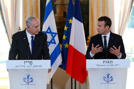 French President Emmanuel Macron and Israeli Prime Minister Benjamin Netanyahu attend a news conference to make a joint declaration at the Elysee Palace in Paris