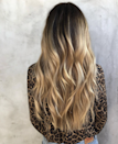 """""""With salons being closed in many states for months, a lot of people have embraced their dark roots,"""" says <a href=""""https://www.instagram.com/katiecartwright901/"""" rel=""""nofollow noopener"""" target=""""_blank"""" data-ylk=""""slk:Katie Cartwright"""" class=""""link rapid-noclick-resp"""">Katie Cartwright</a>, a colorist at Nine Zero One. """"What I like about this look is it keeps your color looking lived-in and sun-kissed. It doesn't have to be a whole situation every time you go to the salon."""" The trick, she says, is to ask your stylist for a hairline highlight and root melt to refresh your current color."""