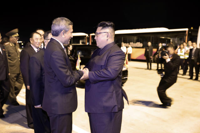 <p>In this photo released by the Ministry of Communications and Information, Singapore, North Korean leader Kim Jong Un, center, is greeted before his departure, at Changi airport, following the summit with U.S. President Donald Trump, Tuesday, June 12, 2018 in Singapore. (Ministry of Communications and Information, Singapore via AP) </p>