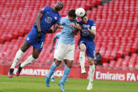 Manchester City's Rodrigo, center, jumps for the ball with Chelsea's Mason Mount, left, and Chelsea's Cesar Azpilicueta during the English FA Cup semifinal soccer match between Chelsea and Manchester City at Wembley Stadium in London, England, Saturday, April 17, 2021. (AP Photo/Ian Walton, Pool)