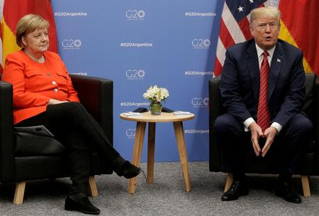 FILE PHOTO: U.S. President Donald Trump and German Chancellor Angela Merkel attend a meeting during the G20 leaders summit in Buenos Aires, Argentina December 1, 2018. REUTERS/Luisa Gonzalez/File Photo
