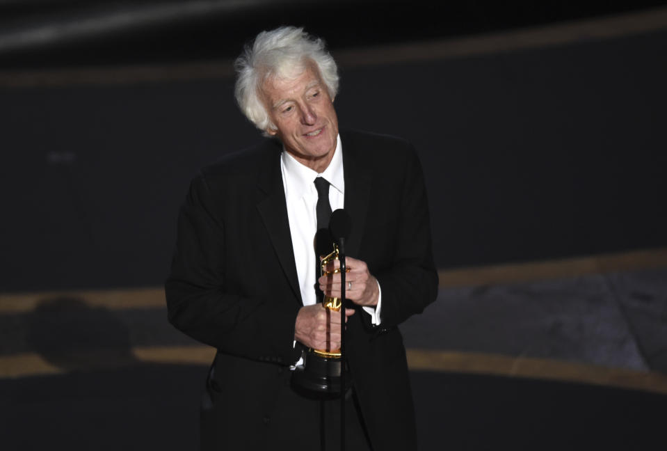 """Roger Deakins accepts the award for best cinematography for """"1917"""" at the Oscars on Sunday, Feb. 9, 2020, at the Dolby Theatre in Los Angeles. (AP Photo/Chris Pizzello)"""