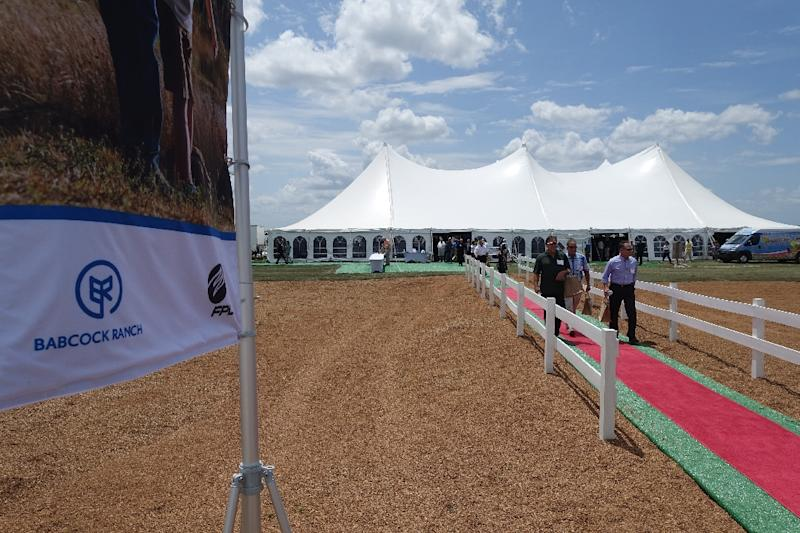 Several hundred visitors convene under a tent to learn about Florida's first eco-friendly city, Babcock Ranch, in Punta Gorda (AFP Photo/Kerry Sheridan)