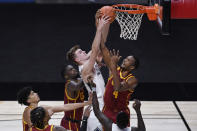 BYU's Matt Haarms, top left, and Southern California's Evan Mobley, top right, fight for a rebound in the second half of an NCAA college basketball game, Tuesday, Dec. 1, 2020, in Uncasville, Conn. (AP Photo/Jessica Hill)