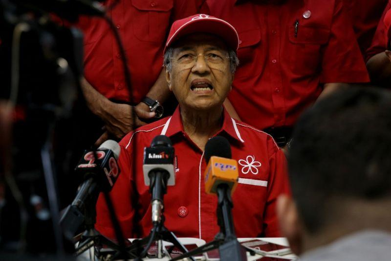 Dr M says fine with venue as long as Nazri debate happens
