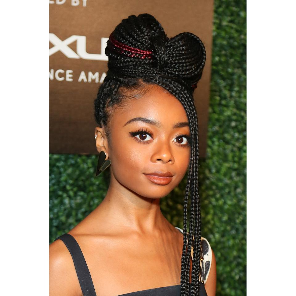 Tired of doing simple buns and ponytails and looking for a more unique updo? Look no further than actress Skai Jackson rocking the cutest braided bow with some of her braids left loose in the front. The burgundy strands of hair give this look an extra bit of flair.