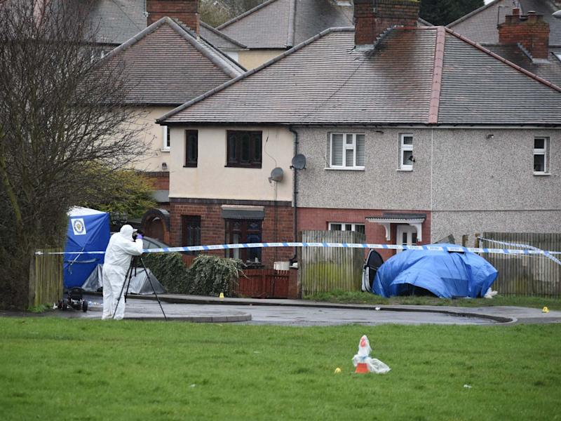 Police at the scene of a double murder in Pensnett Road, Brierley Hill, West Midlands, where two men were stabbed to death during a suspected robbery at a cannabis factory, 20 February 2020: Matthew Cooper/PA