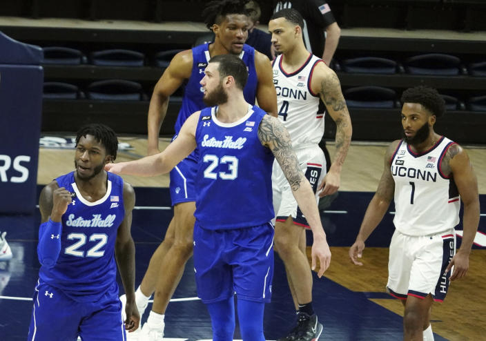 Seton Hall guard Myles Cale (22) and forward Sandro Mamukelashvili (23) react after defeating Connecticut in an NCAA college basketball game, Saturday, Feb. 6, 2021, at Harry A. Gampel Pavilion in Storrs, Conn. (David Butler II/Pool Photo via AP)