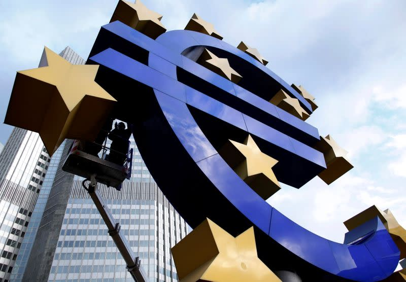 FILE PHOTO: Workers maintain the huge Euro logo in front headquarters of ECB in Frankfurt