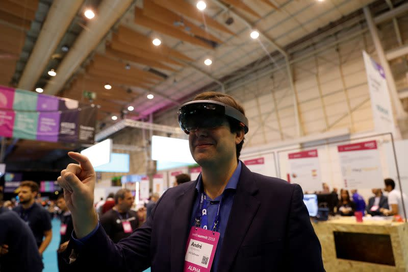 FILE PHOTO: A visitor wears virtual reality glasses during the Websummit in Lisbon, Portugal