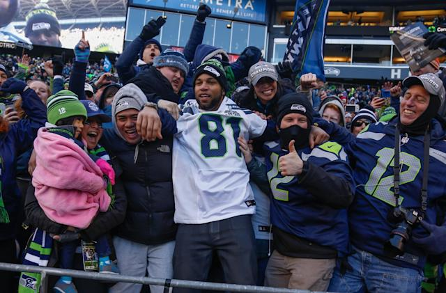 SEATTLE, WA - FEBRUARY 05: Wide receiver Golden Tate #81 of the Seattle Seahawks celebrates with fans during ceremonies following the Seahawks' Super Bowl XLVIII Victory Parade at CenturyLink Field on February 5, 2014 in Seattle, Washington. (Photo by Otto Greule Jr/Getty Images)