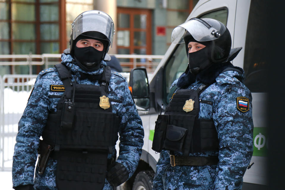 Federal Bailiff service officers stand guard at the Babushkinsky district court prior to the start of the trial against opposition leader Alexey Navalny in Moscow, Russia, Saturday, Feb. 20, 2021. Two trials against Navalny will be held in the court will consider an appeal against his imprisonment in the embezzlement case and will announce a verdict in his the defamation case. (AP Photo/Alexander Zemlianichenko)