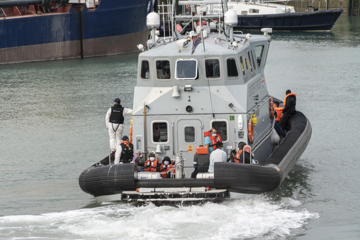 Migrants brought ashore by the border force at the port of Dover.  More and more migrants are sailing in small boats out of French territorial waters to the English Channel where they are legally brought ashore by British border forces.  Migrants can then apply for asylum in the UK.  (Photo by Edward Crawford / SOPA Images / Sipa USA)