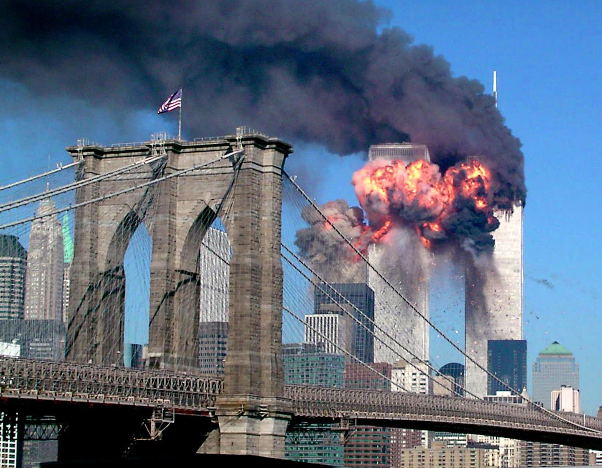 "The South Tower of the World Trade Center explodes in flames after being hit by the hijacked airliner now universally known as ""the second plane,"" United Airlines Flight 175, September 11, 2001. This photo -- with its black smoke; the shocking, brilliant, colossal flames; the cloudless sky; the beautiful Brooklyn Bridge flying the American flag -- captures so much of the story of the day that, if one were to create a composite picture to illustrate the idea of ""9/11,"" the result might look very much like this astonishing shot. <br><br>(Photo: STR/Reuters /Landov)<br><br>For the full photo collection, go to <a target=""_blank"" href=""http://www.life.com/gallery/59971/911-the-25-most-powerful-photos#index/0"">LIFE.com</a>"