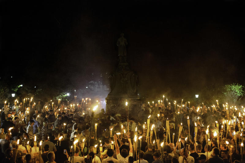 Neo Nazis, Alt-Right, and White Supremacists encircle counter protestors at the base of a statue of Thomas Jefferson after marching through the University of Virginia campus with torches in Charlottesville, Va., USA on August 11, 2017. (NurPhoto via Getty Images)