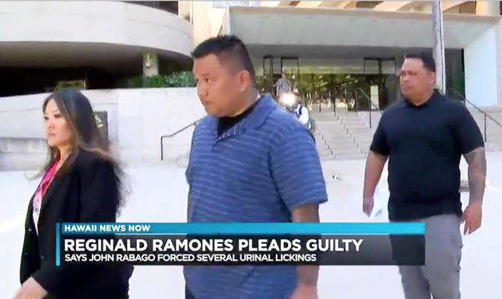 FILE - This undated file photo from video provided by Hawaii News Now shows Honolulu police officer John Rabago outside federal court in Honolulu. A former Honolulu police officer has been sentenced to four years in prison for forcing a homeless man to lick a public urinal. A U.S. judge sentenced a former Honolulu police officer Wednesday, July 15, 2020, to four years in prison for forcing a homeless man to lick a public urinal, telling him to imagine someone doing that to his two young daughters. Rabago offered apologies to the victim. (Hawaii News Now via AP, File)