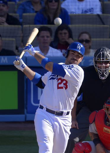 Los Angeles Dodgers' Adrian Gonzalez hits an RBI-single during the third inning of their baseball game against the St. Louis Cardinals, Saturday, May 25, 2013, in Los Angeles. (AP Photo/Mark J. Terrill)