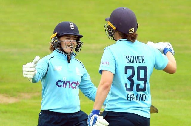 England's Tammy Beaumont and Nat Sciver (right) led England Women to victory over India in the first ODI