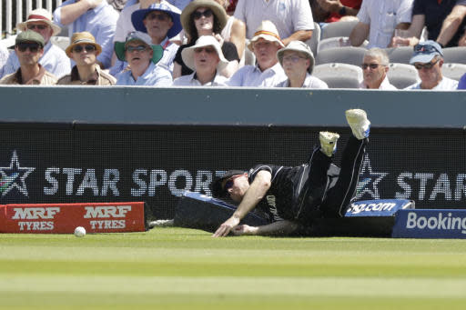 New Zealand's Martin Guptill stops a four during the Cricket World Cup match between New Zealand and Australia at Lord's Cricket Ground in London, England, Saturday, June 29, 2019. (AP Photo/Matt Dunham)