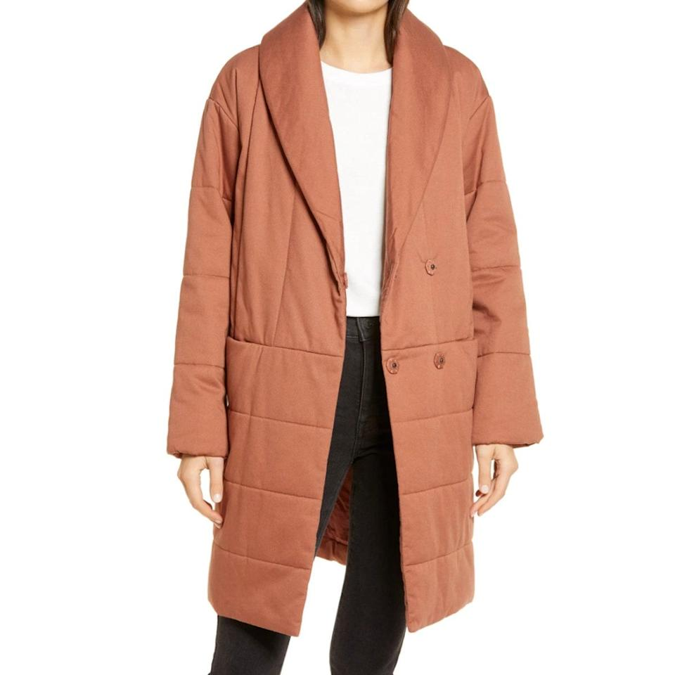 """Cozy up under this longline <a href=""""https://www.glamour.com/gallery/best-down-jackets?mbid=synd_yahoo_rss"""" rel=""""nofollow noopener"""" target=""""_blank"""" data-ylk=""""slk:puffer coat"""" class=""""link rapid-noclick-resp"""">puffer coat</a>, made entirely of recycled polyester. We recommend sizing up so you can comfortably layer it with heavier knits on colder days. $198, Nordstrom. <a href=""""https://www.nordstrom.com/s/madewell-dumont-quilted-coat/5739803?"""" rel=""""nofollow noopener"""" target=""""_blank"""" data-ylk=""""slk:Get it now!"""" class=""""link rapid-noclick-resp"""">Get it now!</a>"""