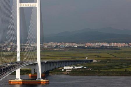 FILE PHOTO - A general view shows the unfinished New Yalu River bridge that was designed to connect China's Dandong New Zone, Liaoning province, and North Korea's Sinuiju, September 11, 2016. REUTERS/Thomas Peter/File Photo