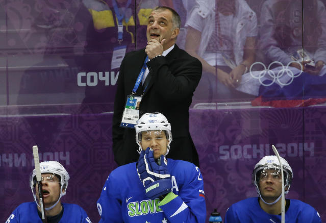 Slovenia head coach Matjaz Kopitar watches the replay of a goal by Sweden in the third period of a men's quarterfinal ice hockey game at the 2014 Winter Olympics, Wednesday, Feb. 19, 2014, in Sochi, Russia. (AP Photo/Mark Humphrey)