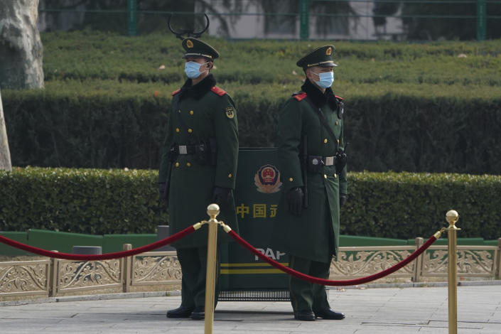 Chinese paramilitary policemen stand guard near the Great Hall of the People before delegates arrive to attend the opening session of the Chinese People's Political Consultative Conference (CPPCC) held in Beijing on Thursday, March 4, 2021. (AP Photo/Ng Han Guan)