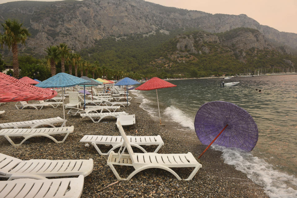 The Oren beach shortly after people were evacuated by boat after wildfires reached the nearby Kemerkoy Power Plant, a coal-fueled power plant, in Milas, Mugla in southwest Turkey, early Thursday, Aug. 5, 2021. (AP Photo)