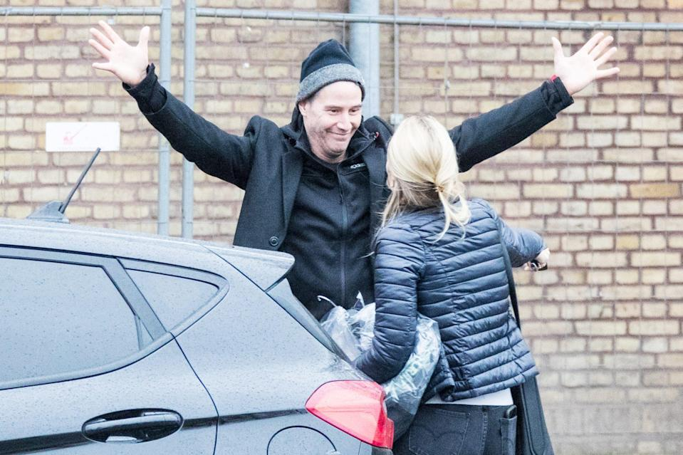 <p>Keanu Reeves greets a friend with a giant hug on Tuesday in Berlin. </p>