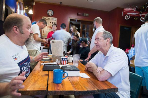 PHOTO: Dan Bishop, right, Republican candidate for North Carolina's 9th District, talks with supporters at Robin's On Main diner in Hope Mills, N.C., on Saturday, August 10, 2019. (Tom Williams/CQ-Roll Call,Inc.)