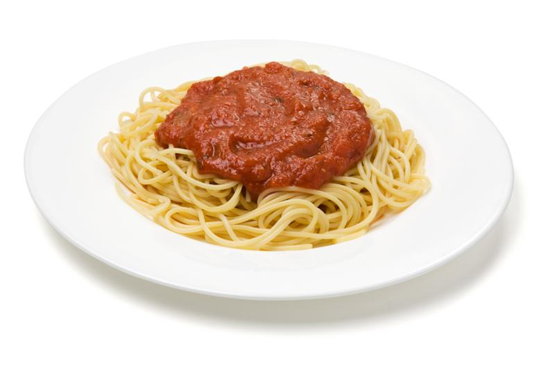 A plate of spaghetti and sauce isolated on white with clipping path.
