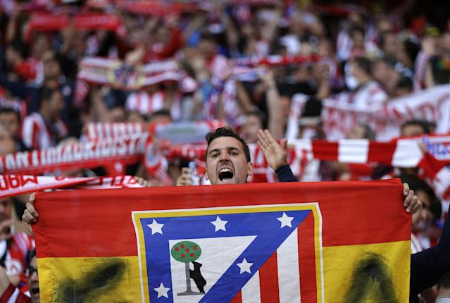 An Atletico supporter shouts slogans, ahead of the Champions League final soccer match between Atletico Madrid and Real Madrid, at the Luz stadium, in Lisbon, Portugal, Saturday, May 24, 2014. (AP Photo/Francisco Seco)
