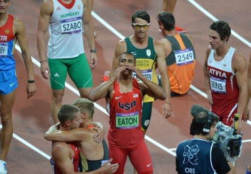 Ashton Eaton celebrates his decathlon gold medal after the final event the 1500m. Usain Bolt admitted Thursday that despite streaking to a unique second successive Olympic sprint double, decathlon champion Ashton Eaton was the best athlete in the world